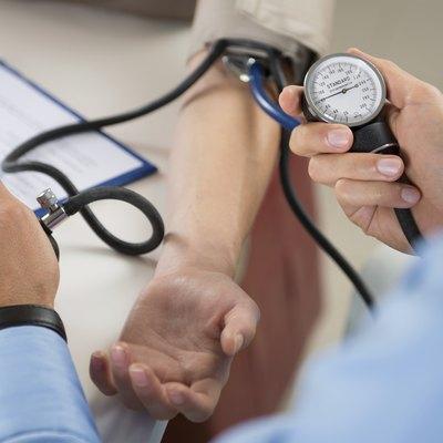 Doctor Measures Pressure In The Patient