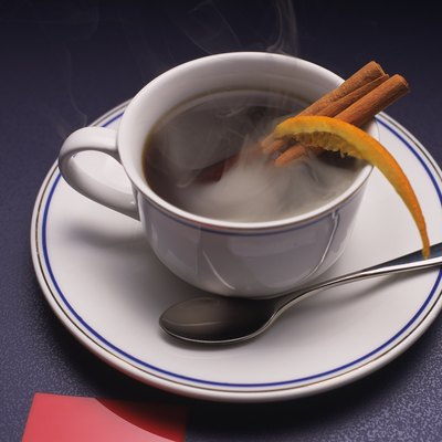 Coffee with Cinnamon Stick and Orange, High Angle View, Full Frame