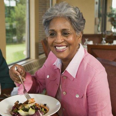 Woman eating vegetable dish