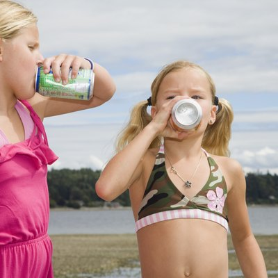 Two girls drinking soda