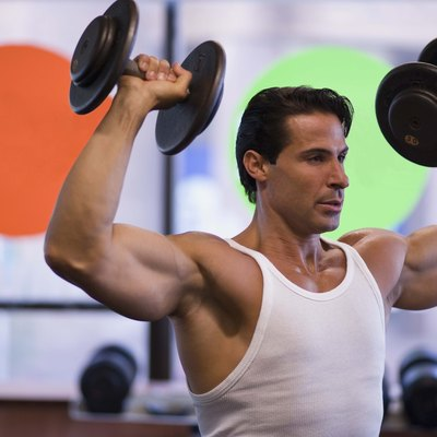 Man lifting weights at gym