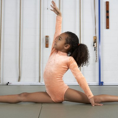 Young girl gymnast practicing her floor exercises