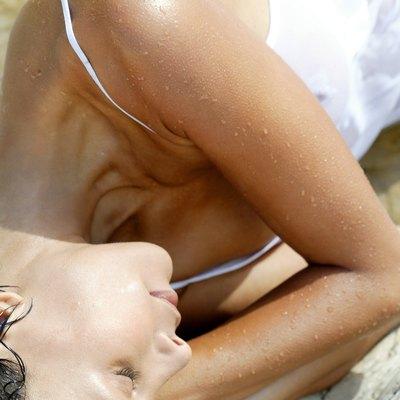 Wet woman sleeping outdoors