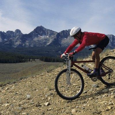 Mountain biker riding downhill in mountain area