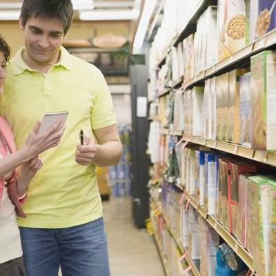 Couple reading list at grocery store