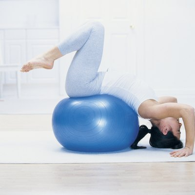 Woman stretching on yoga ball