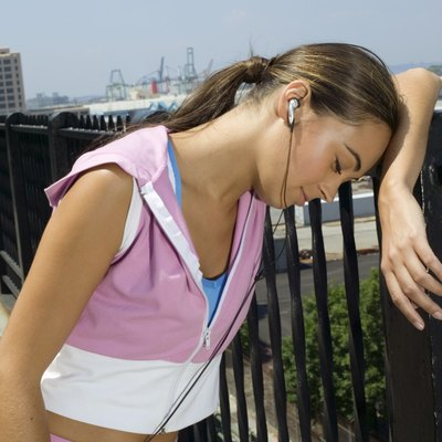 Woman resting on railing