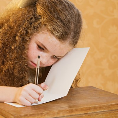 Girl writing a greetings card