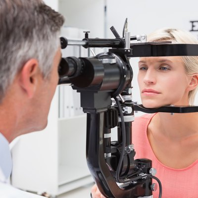 Optometrist examining blonde woman