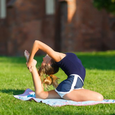 Pretty young girl doing yoga exercises