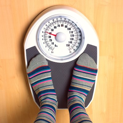 Female anorexic weighing herself