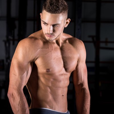 Handsome muscular young man in gym