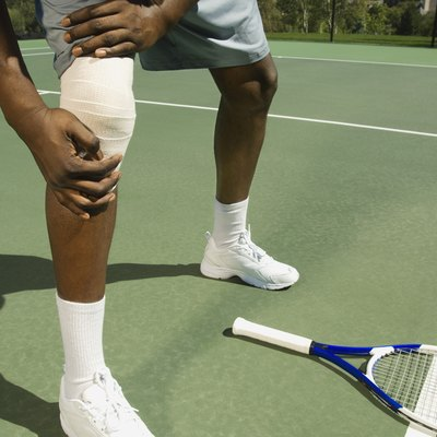 Tennis player with bandaged knee
