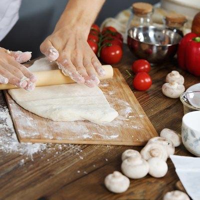 Cook prepare pizza dough