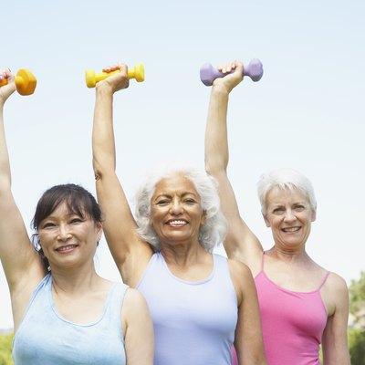 Multi-ethnic senior women lifting weights