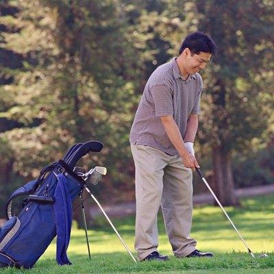 Asian man playing golf