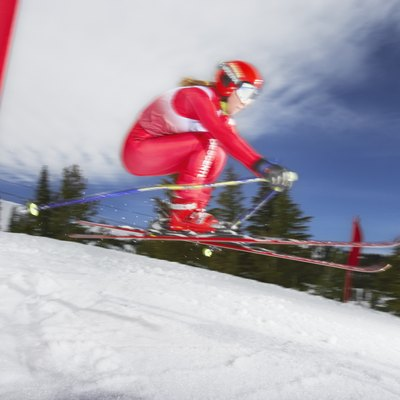 Female skier in giant slalom ski race (blurred motion)