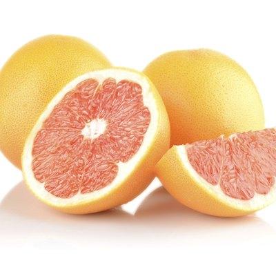 Studio shot sliced some grapefruits isolated white