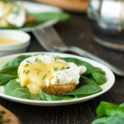 Poached egg on a piece of bread with spinach
