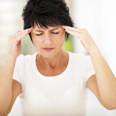 mid age woman having headache