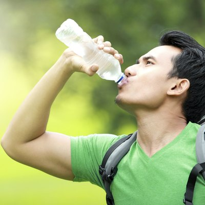 thirsty man drinking a bottle of water