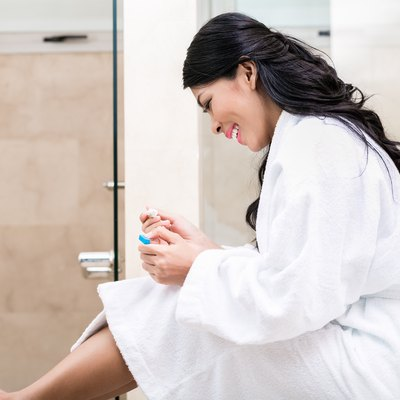 Asian woman being joyfully pregnant