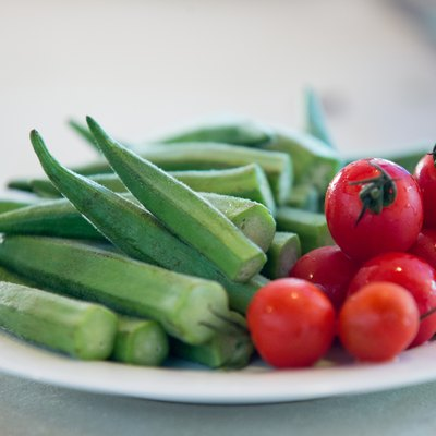 okra and cherry tomatoes on a plate