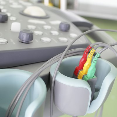 Fragment of an ultrasound machine. Color ECG sensors.