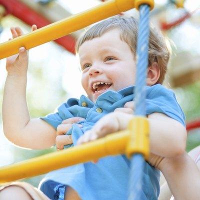 Little boy climbing ladder