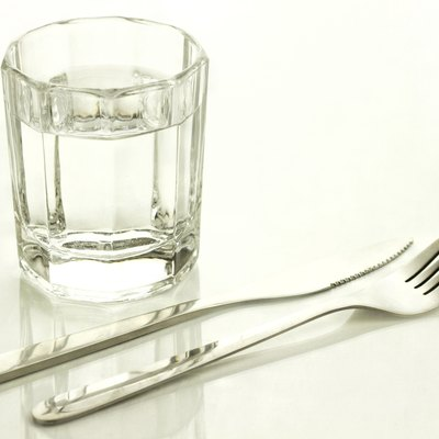 Knife and fork with a glass of water