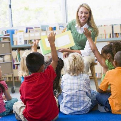 Kindergarten teacher reading to children