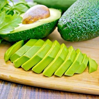 Avocado slices on board