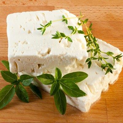 Feta cheese on wood board
