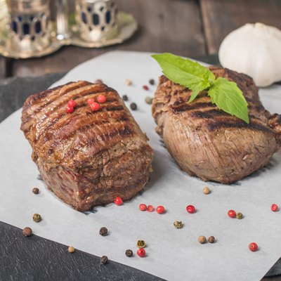 Grilled beef steak close up on paper