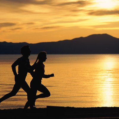 Silhouette of couple jogging