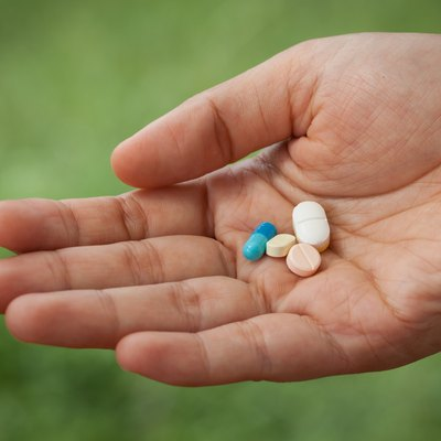 Closeup pills on woman hand