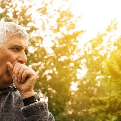 Coughing senior man.