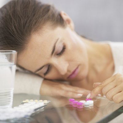 closeup on stressed young woman playing with pills