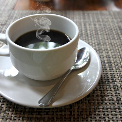Hot Black coffee in a white cup on the table.