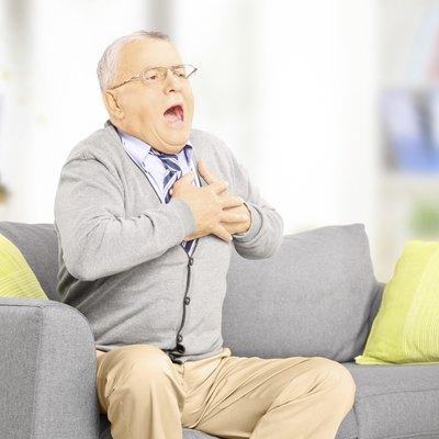 Senior man having a heart attack at home