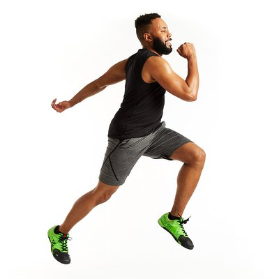 man doing a jump against a white backdrop