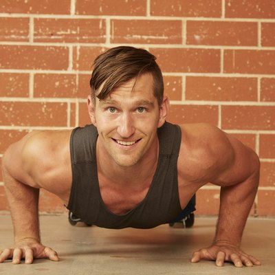 man doing a push-up exercise in a gym