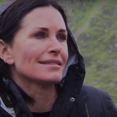 "Courteney Cox speaks to TV host Bear Grylls on the Monday, August 22, 2016, episode of ""Running Wild With Bear Grylls."""