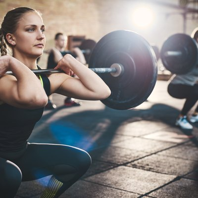 woman lifting weights in a crossfit class