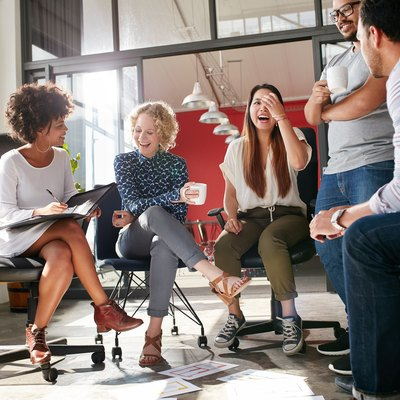 A group of people having fun during a meeting.