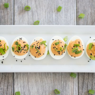 Kimchi deviled eggs on a plate.
