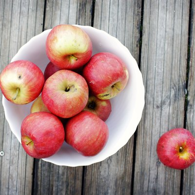 apples covered with pesticides in a bowl