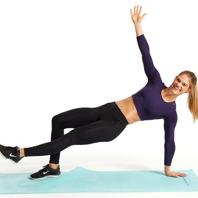 woman doing breakdance thruster move on yoga mat