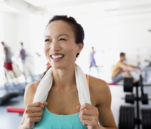 Woman happy and confident working hard in gym