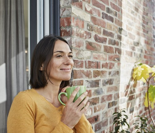 woman drinking caffeine for natural remedy for headache